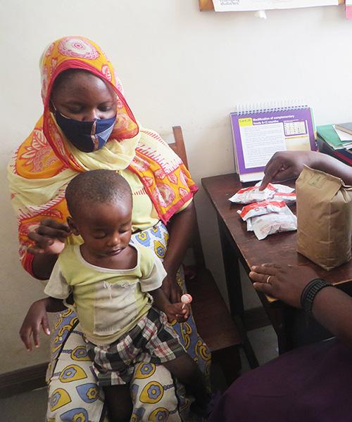 Feeding malnourished children in Kenya